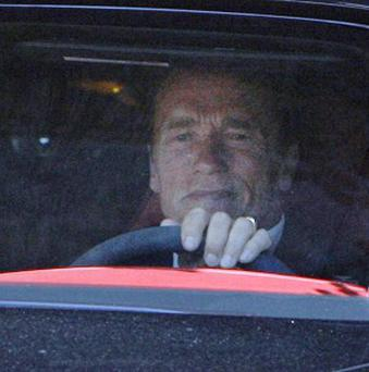 Arnold Schwarzenegger is seen leaving his office earlier this week after he admitted fathering a child with a member of his household staff (AP)