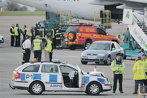 A damaged airport police car, with the hijacked fire brigade vehicle in the background, at Cork airport yesterday