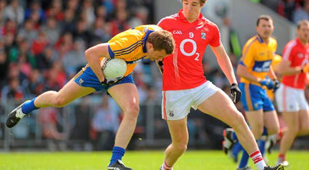 Clare's Niall Browne tries to get away from Aidan Walsh at Pairc Ui Chaoimh. Photo: Pat Murphy / Sportsfile