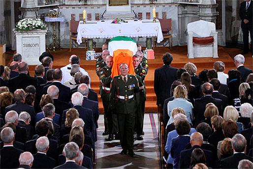 Dr Garret FitzGerald's coffin is taken from the Sacred Heart Church in Donnybrook, Dublin yesterday