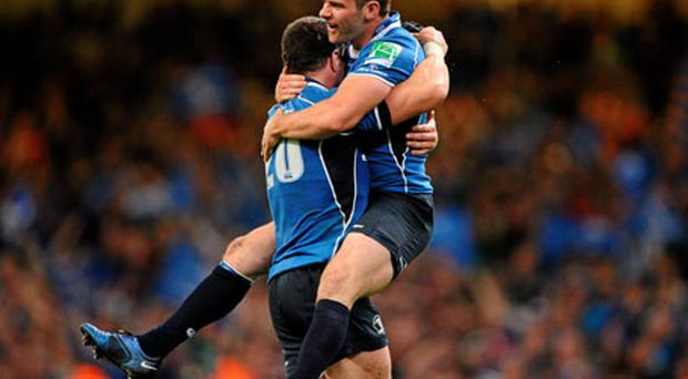 Leinster's Fergus McFadden jumps for joy into the arms of team-mate Shane Jennings at the final whistle.