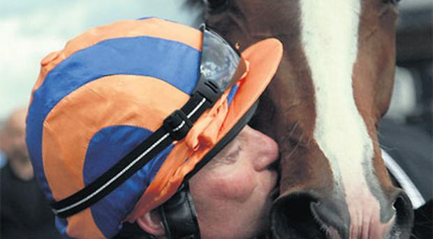 Seamus Heffernan kisses Misty For Me after their victory in the Etihad Airways Irish 1,000 Guineas at The Curragh