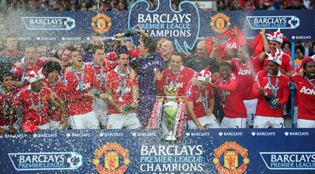 Manchester United's players celebrate with the English Premier League trophy after beating Blackpool at Old Trafford yesterday. Photo: Getty Images