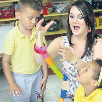 Moving on: The fun of primary school can't last forever, as Caroline Walkin's pupils at Basin Lane school will learn.