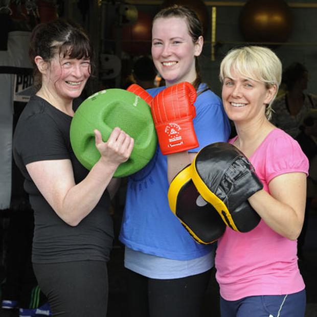 Packing a punch: Anne Reilly, Katherine Gough and Orla Doyle are all converts to boxing and are regulars at Mick Dowling's gym in Dublin