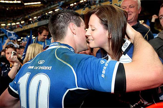 Man of the MAtch Johnny Sexton gets akiss from Girlfriend Laura Priestly. Photo: Ray Cullen
