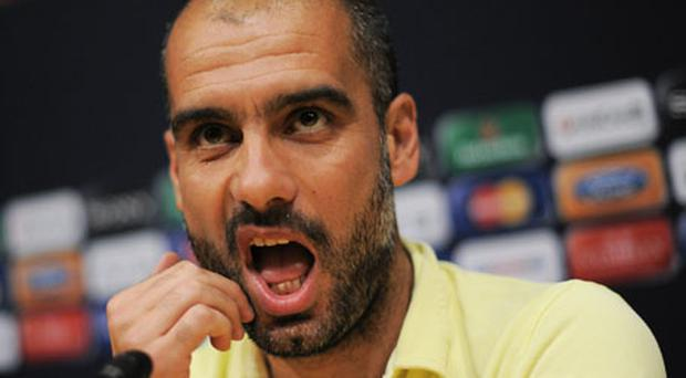 Pep Guardiola in pensive mood at Barcelona's press conference at the Nou Camp yesterday. Photo: Getty Images