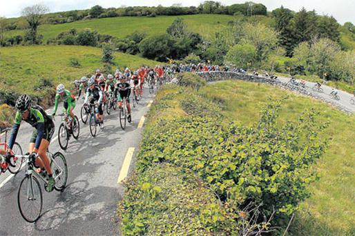 The peloton makes its way up The Corkscrew yesterday during the second stage of the Ras from Portumna to Kilrush. Photo: Lorraine O'Sullivan / INPHO
