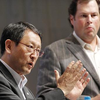Toyota president Akio Toyoda, left, speaks as Salesforce.Com chief executive Marc Benioff looks on during a joint press conference (AP)