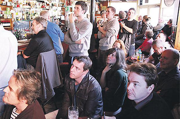 David McWilliams watches Barack Obama's speech in Fallons pub in Dublin's city centre on Monday