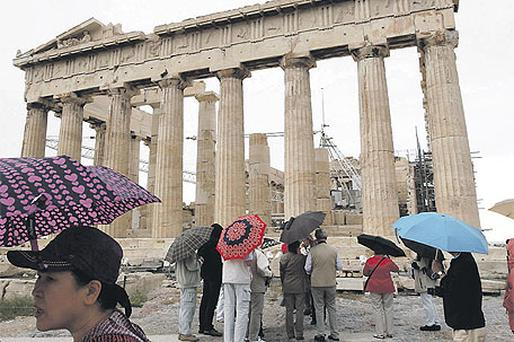 Tourists pause to take in Greece's famous Parthenon