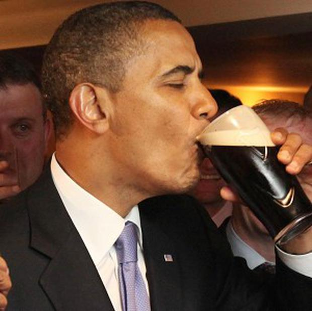 US president Barack Obama with a pint of Guinness