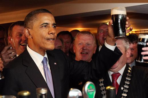 US President Barack Obama enjoys a glass of Guinness in his ancestral home of Moneygall. Photo: Getty Images