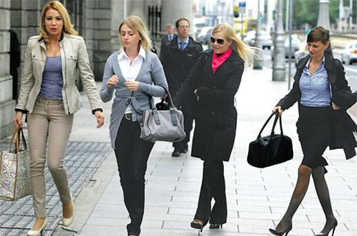 Ryanair staff (from left) Silvia Hernandez, Magdelena Moszynska, Ingrid Pilkova and Stanka Haluskova, who featured in the calendar, arriving at the High Court yesterday