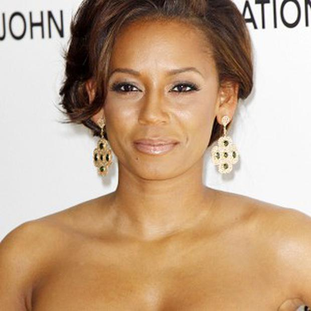 Mel B joked that she almost got her leopard print catsuit on again
