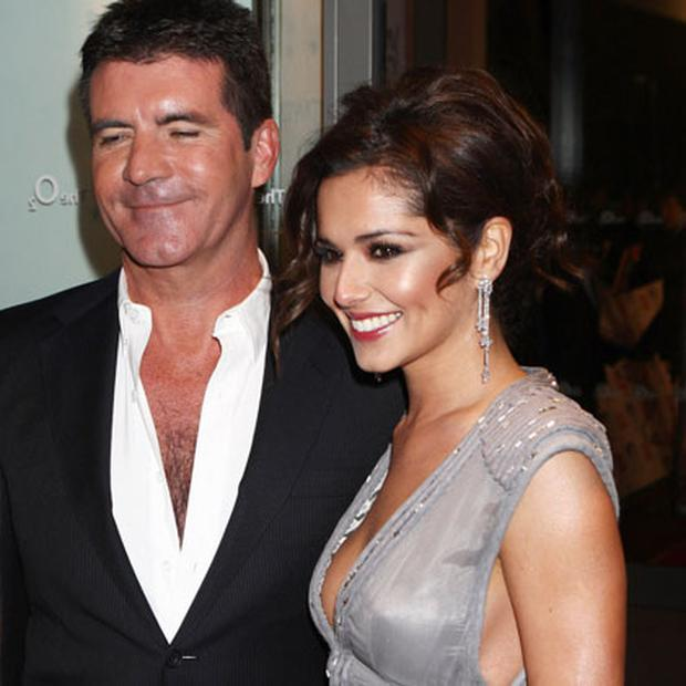 Simon Cowell and Chery Cole Photo: Getty Images