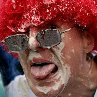 Competitor Paul Humphries takes part in the World Custard Pie Championships at Coxheath Village Hall in Kent
