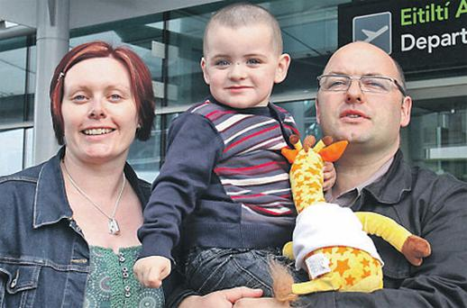 Liam Heffernan with his parents Mary and Tony before they went to New York last month