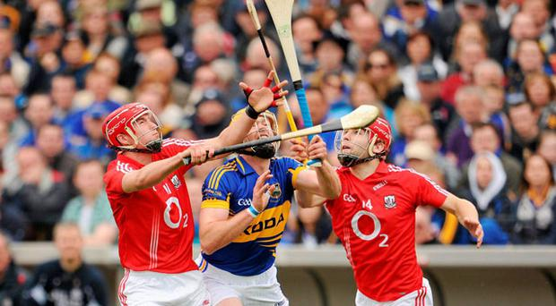 Cork's Cian McCarthy, left, and Paudie O'Sullivan in action against Tipperary's Padraic Maher in yesterday's Munster SHC quarter-final. Photo: RAY MCMANUS / SPORTSFILE