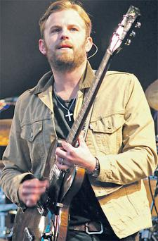 Kings of Leon lead singer Caleb Followill on stage