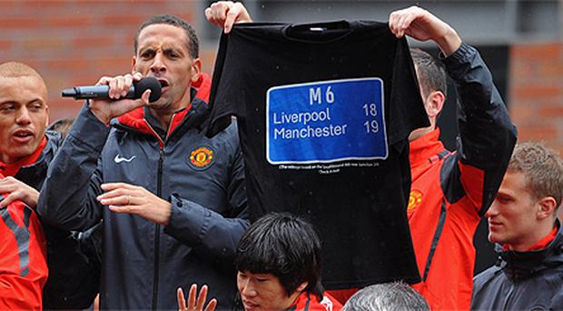 Rio Ferdinand addresses fans during Manchester United's Premier League victory parade through Manchester. Photo: Press Association