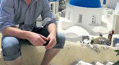 Thomas takes a breather in Oia, Santorini