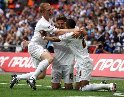 LONDON, ENGLAND - MAY 30: Scott Sinclair of Swansea celebrates with Fabio Borini (#15) and Alan Tate after he scores a penalty during the npower Championship Playoff Final between Reading and Swansea City at Wembley Stadium on May 30, 2011 in London, England. (Photo by Dean Mouhtaropoulos/Getty Images)