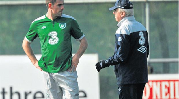 Giovanni Trapattoni and Darron Gibson have a chat at an Irish training session back in March. The Manchester United midfielder is unavailable for Ireland's European Championship qualifier against Macedonia on Saturday