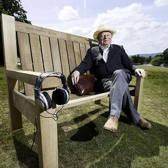 Broadcaster John Sergeant on his talking bench at Petworth House and Park, West Sussex
