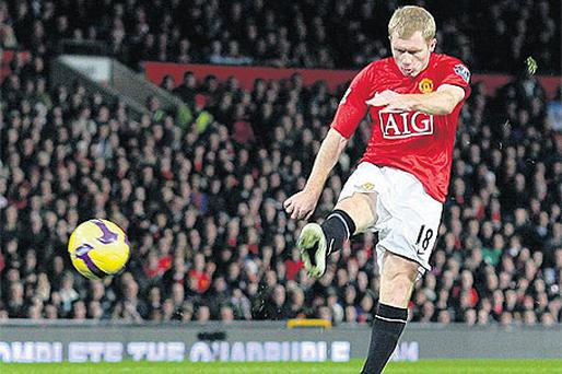 Paul Scholes, who announced his retirement yesterday, scores one of his trademark volleys against Fulham at Old Trafford in 2009