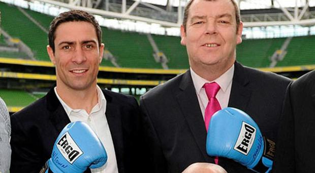 Gerry Fleming of Neilstown Boxing Club and Olympic silver medallist Kenny Egan at the Aviva Stadium yesterday where 12 dedicated volunteers who have made outstanding contributions to sport in Ireland were honoured by the Federation of Irish Sports