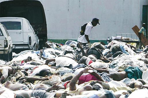 Hundreds of bodies were piled on the streets in Port-au-Prince, Haiti, after the earthquake last year