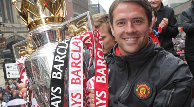 Michael Owen will be with Manchester United for at least another year. Photo: Getty Images