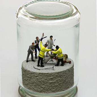 The artwork depicts Take That falling foul of the law