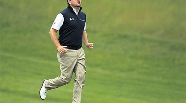 Graeme McDowell had a spring in his step at Celtic Manor yesterday as he returned to the scene of Europe's Ryder Cup success and his own Welsh Open victory