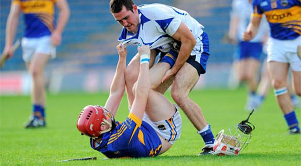 Waterford's Stephen Daniels gets to grips with Sean Curran of Tipperary during their match in Semple Stadium last night