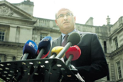 Fine Gael's Environment Minister Phil Hogan speaking to on the steps of Government Buildings earlier this week