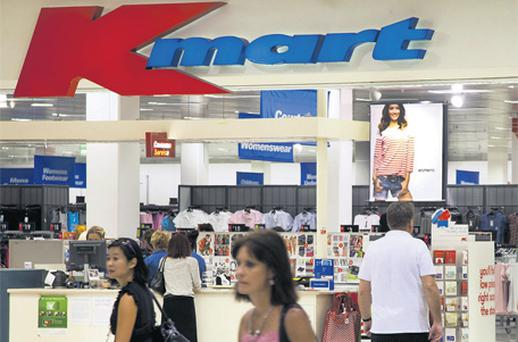 Shoppers enter and exit Wesfarmers Ltd's Kmart store in Innaloo, a suburb of Perth, Australia. The economy shrank in the first quarter by the most in 20 years
