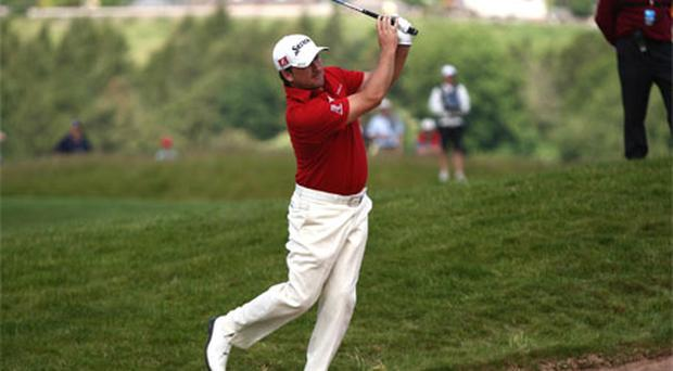 Graeme McDowell plays on to the fifth green during the opening day of the Wales Open at Celtic Manor yesterday