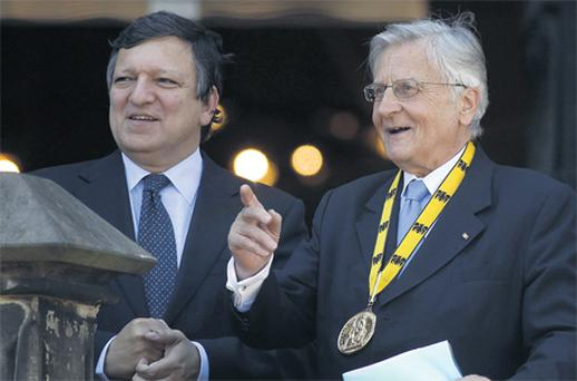 ECB President Jean-Claude Trichet with European Commission President Jose Manuel Barroso after Trichet received the Charlemagne Prize 2011, the 'Karlspreis', in the western German city of Aachen yesterday for merits of the extension of the European Union