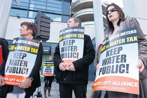 TDs Joan Collins, Richard Boyd Barrett and Clare Daly protest against introduction of water charges