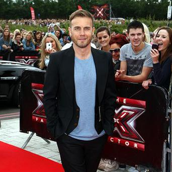 Gary Barlow has his hands full with The X Factor and touring