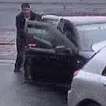 CCTV footage of two suspects pushing their car onto a petrol station forecourt after running out of fuel (GMP)