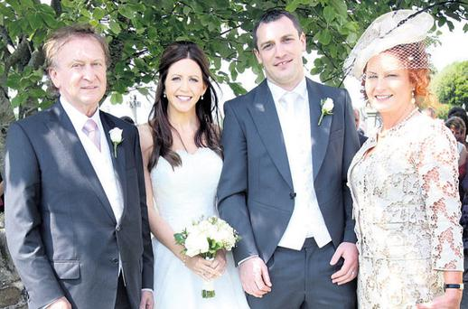 INTIMATE AFFAIR: Developer Sean Mulryan with his daughter Linda, her husband Barry Condron, and wife Bernadine at St Kevin's Church, Hollywood, Co Wicklow. Photo: Tony Gavin