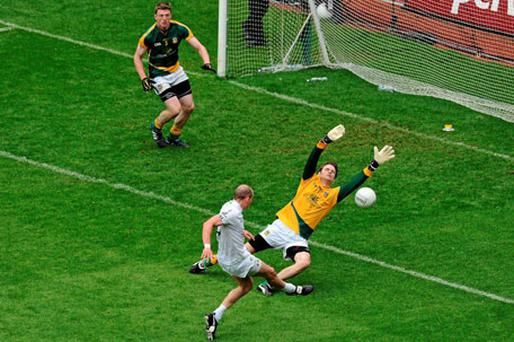 Meath goalkeeper Brendan Murphy makes a great save to deny James Kavanagh. Photo: Brendan Moran / Sportsfile