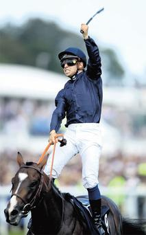 Jockey Mickael Barzalona's extraordinary celebration on the Coolmore-owned Pour Moi as the winning partnership pass the winning post in Saturday's Derby.