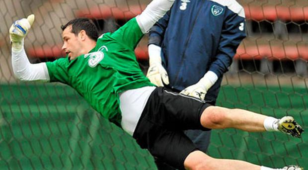 Ireland goalkeepers David Forde and Brian Murphy (behind), in action during their training session ahead of tonight's friendly against Italy in Liege, Belgium. Photo: David Maher / Sportsfile