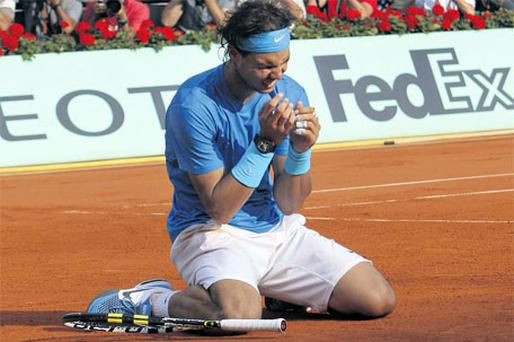Rafael Nadal celebrates on Sunday after beating Roger Federer to win his sixth French Open title and 10th Grand Slam.