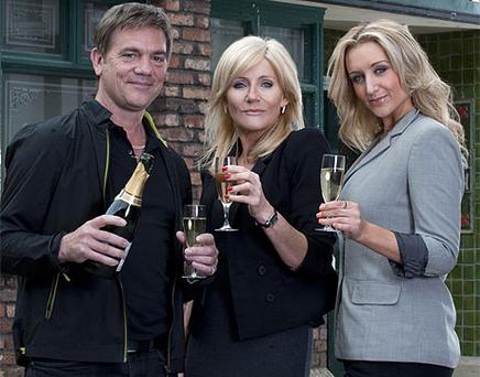 John Michie, Michelle Collins and Catherine Tyldesley are Corrie's new family. Photo: PA