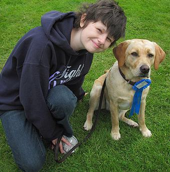 Alice Pyne, pictured with her dog